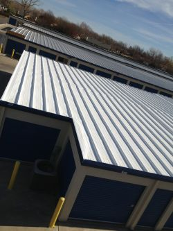 ... SureCoat Roof Coating Over A Flat Metal Roof Surecoat_metal_roof_systems