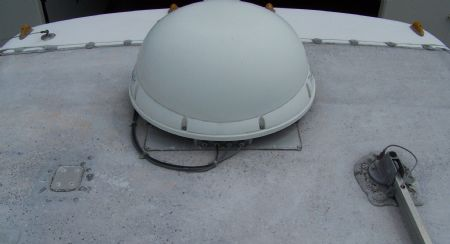 CLOSE-UP OF A MOTORHOME ROOF BEFORE THE APPLICATION OF THE SURECOAT RV ROOF REPAIR SYSTEM.