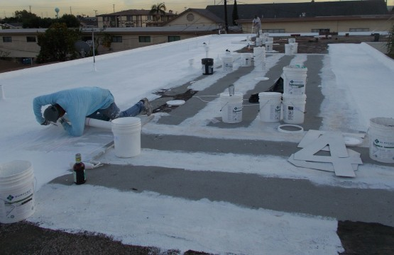 SureCoat Roof Install over gravel roofing
